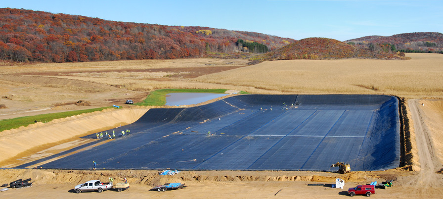 Aquaculture company pond lining installation yunker for Pond liner installation